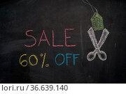 Sale 60% off. Sale and discount price sign with scissors cutting price... Стоковое фото, фотограф Zoonar.com/Piotr Stryjewski / easy Fotostock / Фотобанк Лори