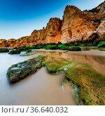Green Stones at Porto de Mos Beach in Lagos, Algarve, Portugal. Стоковое фото, фотограф Zoonar.com/Andrey Omelyanchuk / easy Fotostock / Фотобанк Лори