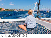 Casual woman relaxing on a summer vacations sailin cruise, sitting... Стоковое фото, фотограф Zoonar.com/Matej Kastelic / easy Fotostock / Фотобанк Лори