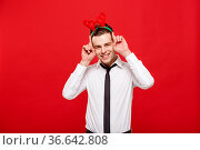 Christmas Concept - Handsome Business man celebrate merry christmas... Стоковое фото, фотограф Zoonar.com/Phongthorn Hiranlikhit / easy Fotostock / Фотобанк Лори