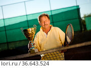 Portrait of an active senior man in his 70s on the tennis court. Стоковое фото, фотограф Zoonar.com/StockLite / easy Fotostock / Фотобанк Лори