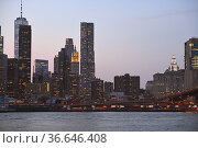 Lower Manhattan Skyline at night. Skyscrapers became signature of New York skyline. Стоковое фото, фотограф Валерия Попова / Фотобанк Лори