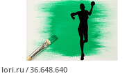 Silhouette of female handball player against green paint stain and paint brush on white background. Стоковое фото, агентство Wavebreak Media / Фотобанк Лори