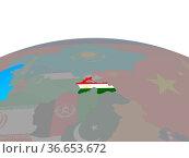 Tajikistan with national flag on political globe. 3D illustration. Стоковое фото, фотограф Zoonar.com/Tomas Griger / easy Fotostock / Фотобанк Лори