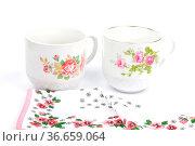 Tuch und Tassen - Cloth and cups. Стоковое фото, фотограф Zoonar.com/lantapix / easy Fotostock / Фотобанк Лори