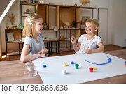 Boy and girl drawing with gouache on their faces. Стоковое фото, фотограф Tryapitsyn Sergiy / Фотобанк Лори