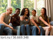Group of happy diverse female and male friends showing plasters after vaccination and taking selfie. Стоковое фото, агентство Wavebreak Media / Фотобанк Лори