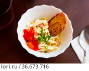 Salad of cabbage, eggs, sausages and mayonnaise with toasted baguette. Стоковое фото, фотограф Яков Филимонов / Фотобанк Лори