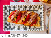 Toasted bread with tuna, anchovies, baked bell pepper and olives. Стоковое фото, фотограф Яков Филимонов / Фотобанк Лори