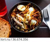 Russian salad Capercaillies Nest - boiled eggs and fried potatoes closeup. Стоковое фото, фотограф Яков Филимонов / Фотобанк Лори