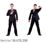 Man in suit with gun isolated on white. Стоковое фото, фотограф Zoonar.com/Elnur Amikishiyev / easy Fotostock / Фотобанк Лори