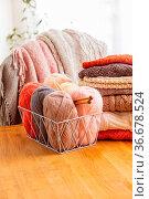 Cozy home hobby - knitting at the living room, house interiour. Стоковое фото, фотограф Zoonar.com/OKSANA SHUFRYCH / easy Fotostock / Фотобанк Лори