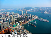 Hong Kong aerial view with urban skyscrapers boat and sea. Стоковое фото, фотограф Zoonar.com/Kokhanchikov / easy Fotostock / Фотобанк Лори