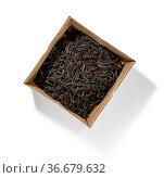 Black tea top view on white background. Стоковое фото, фотограф Zoonar.com/BUTENKOV ALEKSEY / easy Fotostock / Фотобанк Лори