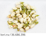 Top view of pile of dried jasmine flowers close up on gray ceramic... Стоковое фото, фотограф Zoonar.com/Valery Voennyy / easy Fotostock / Фотобанк Лори