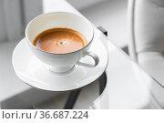 Espresso coffee in a white cup. Стоковое фото, фотограф EugeneSergeev / Фотобанк Лори