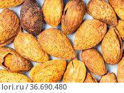 Food background - many cracked almond drupes. Стоковое фото, фотограф Zoonar.com/Valery Voennyy / easy Fotostock / Фотобанк Лори