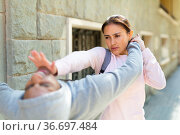 Strong woman using forceful blow in the eyes of rapist on street. Стоковое фото, фотограф Яков Филимонов / Фотобанк Лори