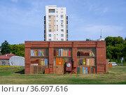 Brick technological booth decorated with the image of a bookshelf in Kazan, Russia. Стоковое фото, фотограф Сергей Фролов / Фотобанк Лори