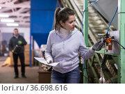 Woman supervising sensors of machine of olive oil pressing. Стоковое фото, фотограф Яков Филимонов / Фотобанк Лори