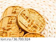 Gourmet Maya glyphs in dark chocolate covered with gold dusting. Стоковое фото, фотограф Zoonar.com/Arina Habich / age Fotostock / Фотобанк Лори