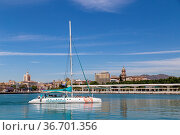 Malaga, Spain - May 24, 2019: A catamaran sailing in the harbour. Стоковое фото, фотограф Zoonar.com/Oliver Foerstner / age Fotostock / Фотобанк Лори