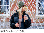 A gorgeous young blonde model poses outdoors while enjoying a winters... Стоковое фото, фотограф Zoonar.com/Walter G Arce Sr Grindstone Media/ASP I / easy Fotostock / Фотобанк Лори