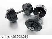 Dumbell isolated on white background. 3D illustration. Стоковое фото, фотограф Zoonar.com/Cigdem Simsek / easy Fotostock / Фотобанк Лори