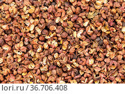 Food background - many dried pink sichuan peppercorns. Стоковое фото, фотограф Zoonar.com/Valery Voennyy / easy Fotostock / Фотобанк Лори