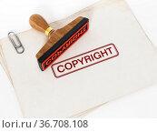 Copyright stamp standing on documents. 3D illustration. Стоковое фото, фотограф Zoonar.com/Cigdem Simsek / easy Fotostock / Фотобанк Лори