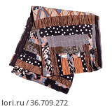 Folded handmade brown patchwork scarf isolated on white background. Стоковое фото, фотограф Zoonar.com/Valery Voennyy / easy Fotostock / Фотобанк Лори