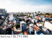 The vast sprawl of buildings in Ho Chi Minh City, otherwise known... Стоковое фото, фотограф Zoonar.com/Chris Putnam / easy Fotostock / Фотобанк Лори
