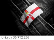 Tag on dark clothing in the form of the flag of the Northern Ireland. Стоковое фото, фотограф Zoonar.com/BUTENKOV ALEKSEY / easy Fotostock / Фотобанк Лори