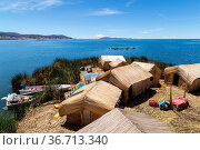 Titicaca Lake, Peru - October 14, 2015: Straw huts and boats on one... Стоковое фото, фотограф Zoonar.com/Oliver Förstner / easy Fotostock / Фотобанк Лори
