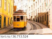 Famous Trolly Carriage on Street in Lisbon Portugal Historic Transportation... Стоковое фото, фотограф Zoonar.com/Hunter Bliss / easy Fotostock / Фотобанк Лори