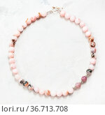 Hand crafted necklace from cherry blossom rose quartz beads on gray... Стоковое фото, фотограф Zoonar.com/Valery Voennyy / easy Fotostock / Фотобанк Лори