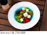 Greek salad with fresh vegetables and feta cheese. Стоковое фото, фотограф Яков Филимонов / Фотобанк Лори