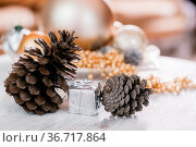 Different kinds cones, Christmas decorations and spruse branch on... Стоковое фото, фотограф Zoonar.com/Konstantin Malkov / easy Fotostock / Фотобанк Лори