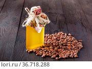 Cedar oil. Bottles with virgin cedar oil and pine nuts on the table. Стоковое фото, фотограф Zoonar.com/Photographer: Andrey N.Cherkasov / easy Fotostock / Фотобанк Лори