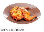Roasted whole flattened chicken on brown plate isolated on white background... Стоковое фото, фотограф Zoonar.com/Valery Voennyy / easy Fotostock / Фотобанк Лори