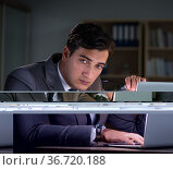 Man staying in the office for long hours. Стоковое фото, фотограф Elnur / Фотобанк Лори