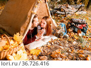 Man and woman hikers camping in autumn nature. Happy young couple... Стоковое фото, фотограф Zoonar.com/Konstantin Malkov / easy Fotostock / Фотобанк Лори