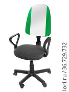 The Nigerian flag - on the back of a chair. Isolated on white background... Стоковое фото, фотограф Zoonar.com/Makarov Alexander / easy Fotostock / Фотобанк Лори