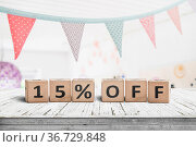 Special price 15 percent off promotion sign on a desk with colorful... Стоковое фото, фотограф Zoonar.com/Polarpx / easy Fotostock / Фотобанк Лори