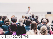 Woman giving presentation on business conference event. Стоковое фото, фотограф Matej Kastelic / Фотобанк Лори
