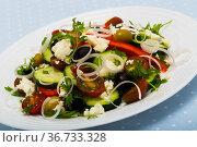 Shopska salad with cucumbers, tomatoes, bell peppers and brynza. Стоковое фото, фотограф Яков Филимонов / Фотобанк Лори