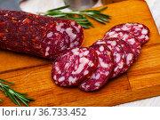 Uncooked smoked semi-dry sausage Braunschweig. Стоковое фото, фотограф Яков Филимонов / Фотобанк Лори