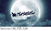 Santa clause sleigh and reindeer flying over the moon. Стоковое фото, агентство Wavebreak Media / Фотобанк Лори