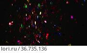 Multicoloured confetti falling on black background. Стоковое фото, агентство Wavebreak Media / Фотобанк Лори