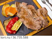 Beef steak with baked potatoes, vegetables, romesco. Стоковое фото, фотограф Яков Филимонов / Фотобанк Лори